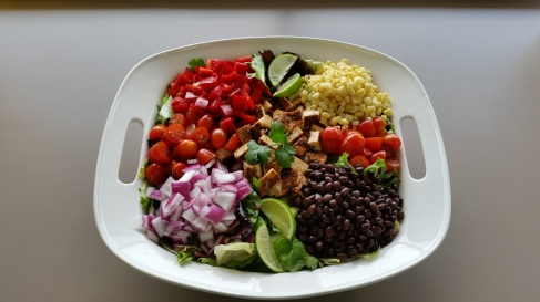 Southwest Chicken Salad with black beans, onions, red pepper, corn, chicken, lime and cherry tomato